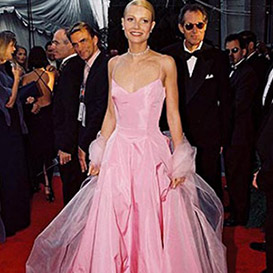 Gwyneth Paltrow on red carpet in pale pink strapless ballgown