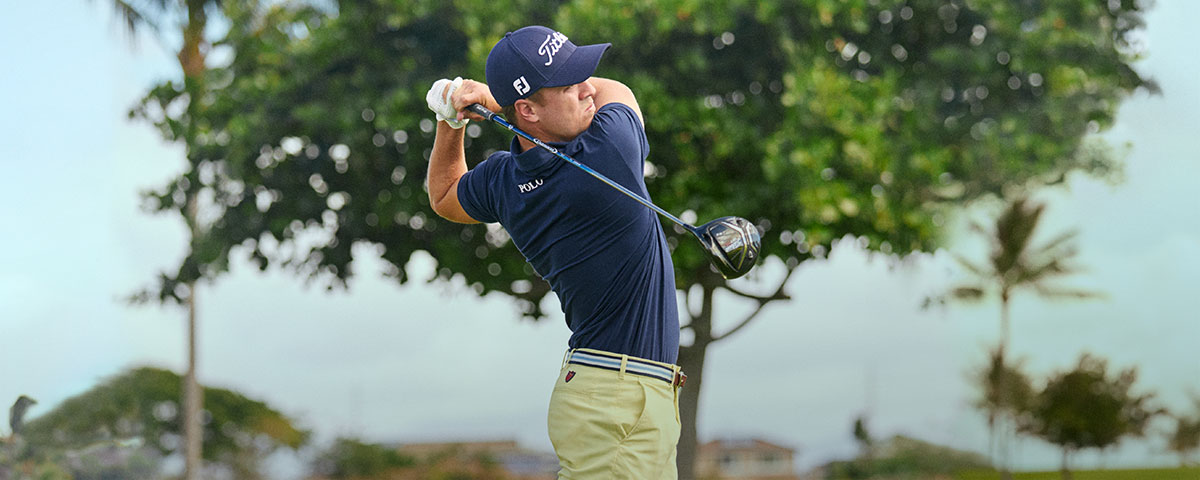 67b8364936e3 ... Ralph Lauren Lifestyle. Justin Thomas mid-swing on course in Polo Golf  shirt   pants