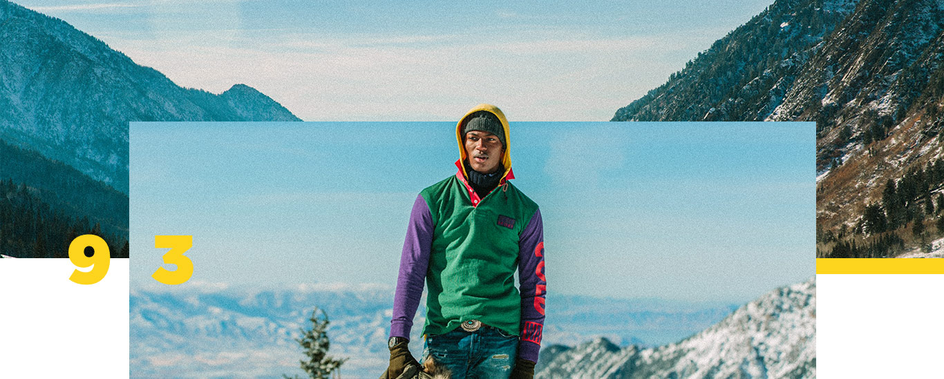 Model on snowy mountain in color-blocked Snow Beach hooded pullover