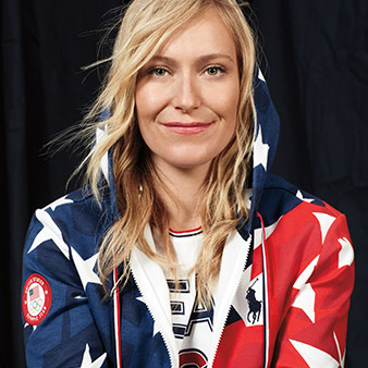 Jamie Anderson in hoodie with graphic print inspired by  Stars and Stripes