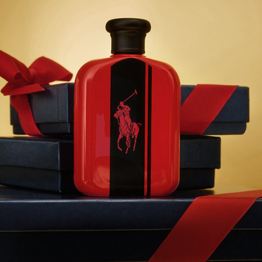 Bottle of Polo Red Intense fragrance and gift boxes.