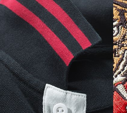 f586e2d6 Close-up image of embroidered tiger & striped collar
