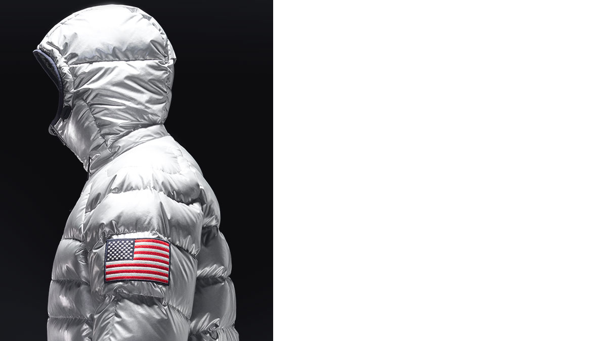 Video of down jacket with American flag patch at arm