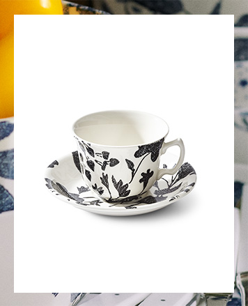 Cup & saucer with dense black & white floral pattern