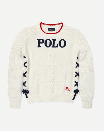 White sweater with intarsia-knit anchor at front and lace-up sides.