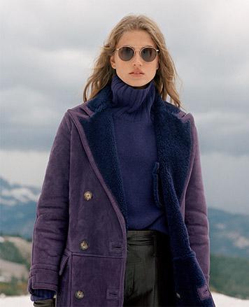 Woman wears purple turtleneck sweater