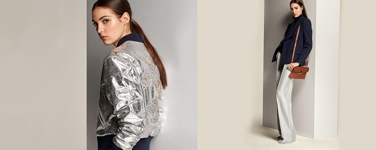Woman in metallic silver bomber jacket; Woman in wide-leg pants & navy peacoat