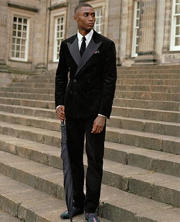 Man on steps in velvet suit