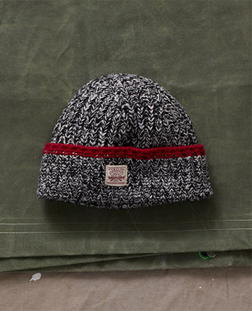 Knit hat with red trim
