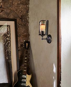 Exposed Edison light bulb wall fixture