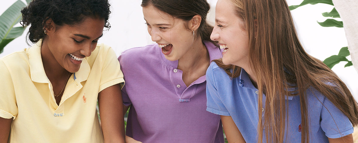 Women in faded pastel-hued Polo shirts