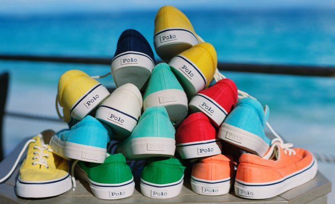 Canvas sneakers in different rainbow hues with Polo logo at back.