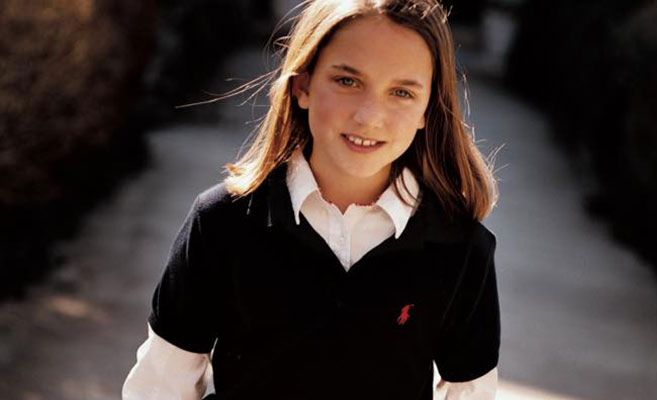Girl wears black Polo layered over white button-down shirt.
