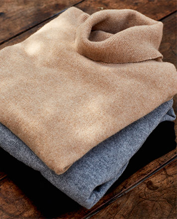 Folded turtlenecks in camel and indigo