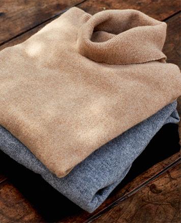 Folded turtlenecks in camel and indigo