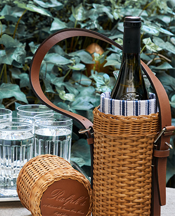 Wicker wine tote with leather handle & blue-and-white striped lining