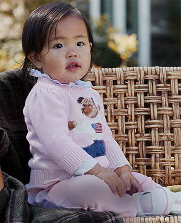 Baby girl wears pink Polo bear sweater and pink leggings.