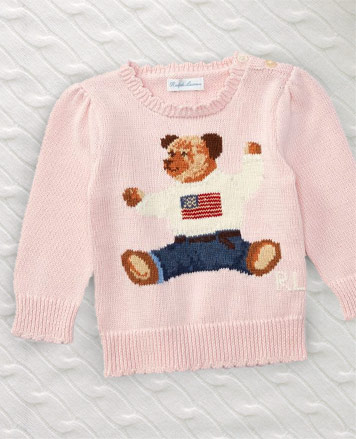 Pink sweater with knit Polo Bear in American flag sweater at front.