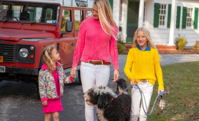 Mother and daughters wear bright Polo apparel.