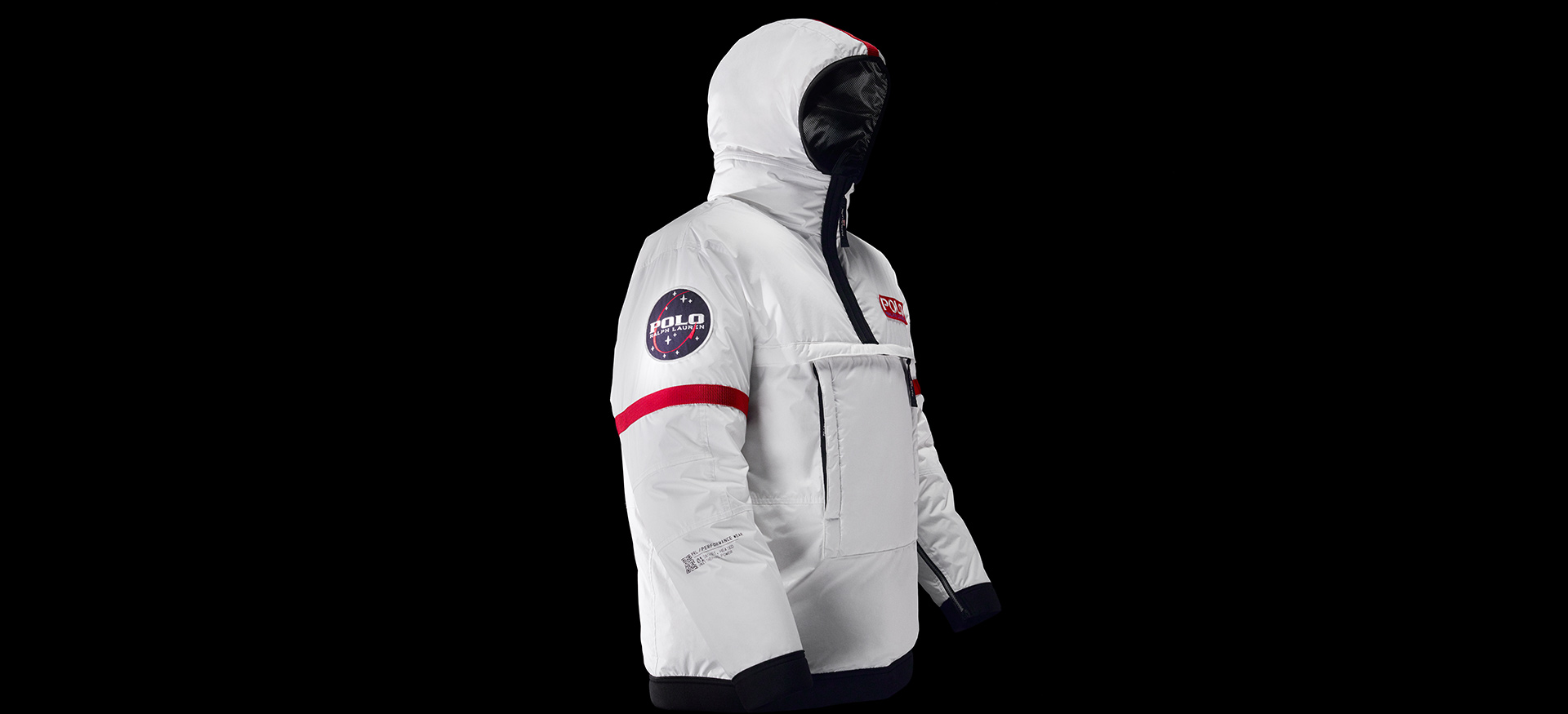 Photograph of hooded white RL Heat jacket against black background