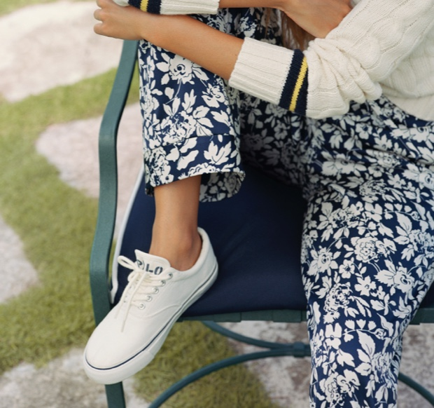 Woman wearing floral-print pants & white Polo lace-up sneakers
