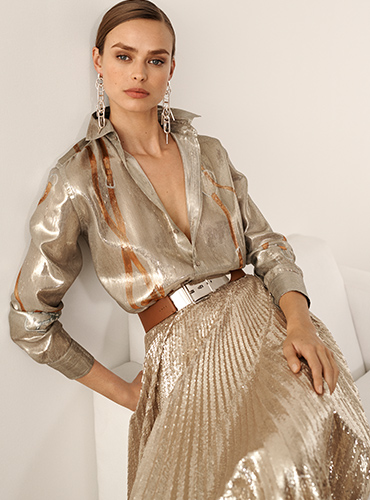 Woman in metallic blouse with brace-inspired accents