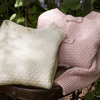 White & pink girls' sweaters with bow details