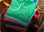 Stack of folded colorful hooded sweatshirts