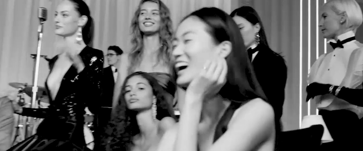 Photograph of models in audience at Janelle Monáe performance at runway show