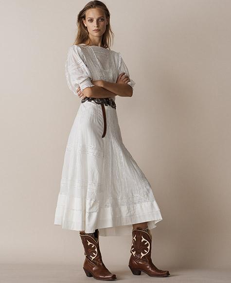 Woman in white cotton voile midi dress