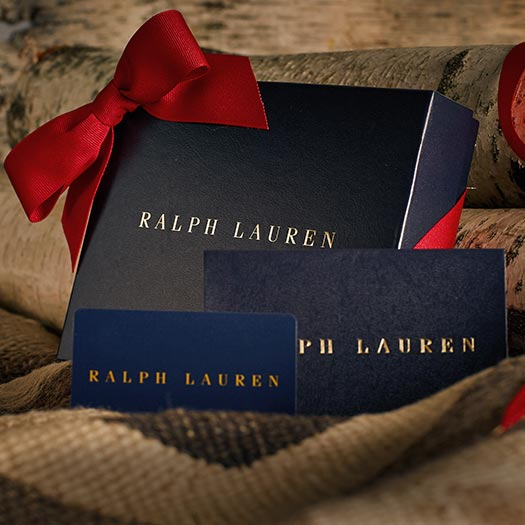 Navy Ralph Lauren gift box with a red ribbon.