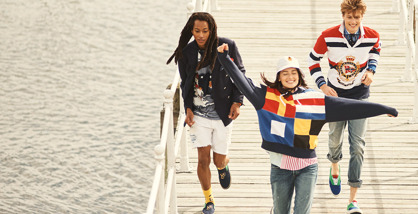 Men & woman on dock in nautical-inspired Polo spring styles