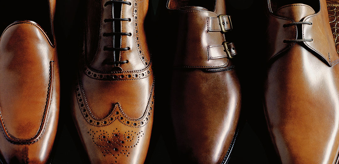 Row of brown leather benchmade wingtip shoes