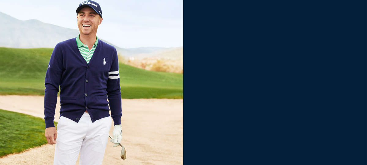 Justin Thomas in navy cardigan with white stripes at sleeves