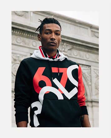 Man in black hoodie with large red 67 & white Polo graphics