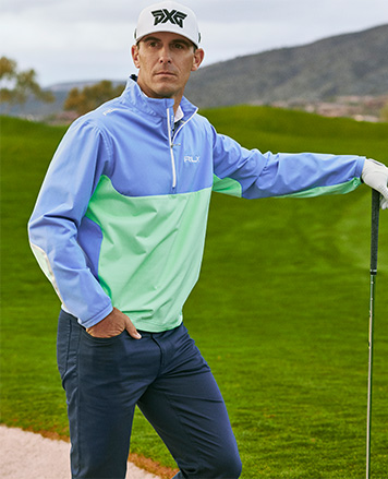 Justin Thomas in navy cardigan with white stripes at sleeve