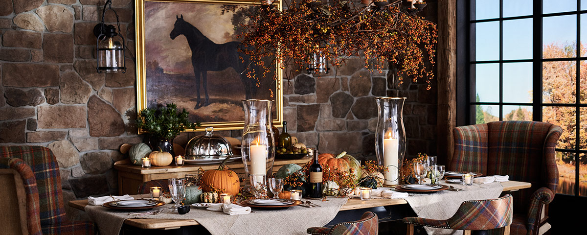 Table with autumn-themed place settings & centerpieces
