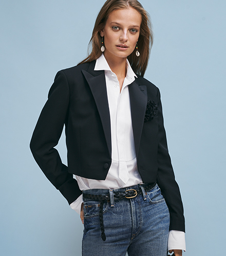 Woman in cropped black tuxedo jacket