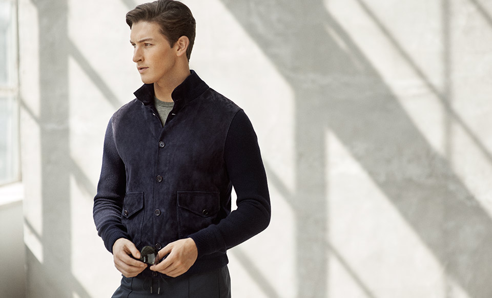 Man in navy shirt with knit sleeves and suede body