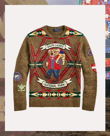 Tan sweater with hiking Polo Bear motif & patches