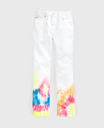 White jeans with bright-hued tie-dye motif at lower legs