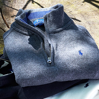 Blue boys' sweater with half-zip placket