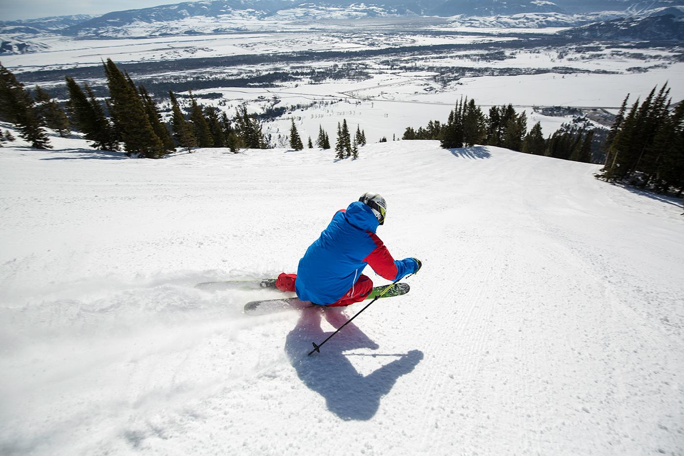 Local skier Tigger Knecht tests out the newly opened terrain, heading full speed down the 3,000-vertical-foot trail called Kemmerer Run