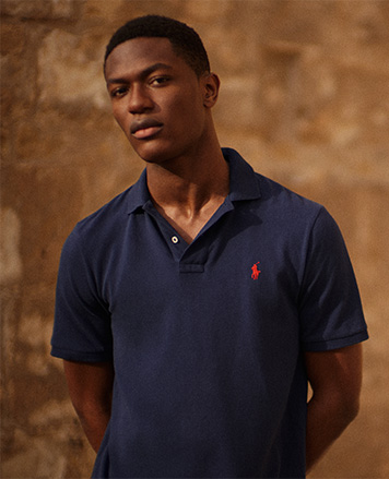 Model wears navy polo shirt