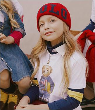 Girl wears Literacy Tee and red beanie.