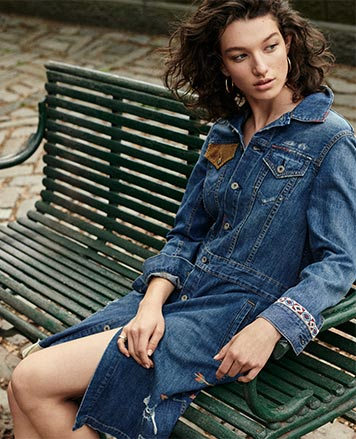 Woman in denim shirtdress with embroidery & leather accents
