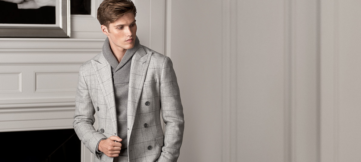 Man in light grey windowpane sport coat & shawl sweater