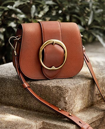 Brown pebbled leather shoulder bag with large buckle at front