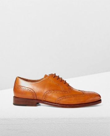 Tan calfskin wingtip shoe with perforation accents