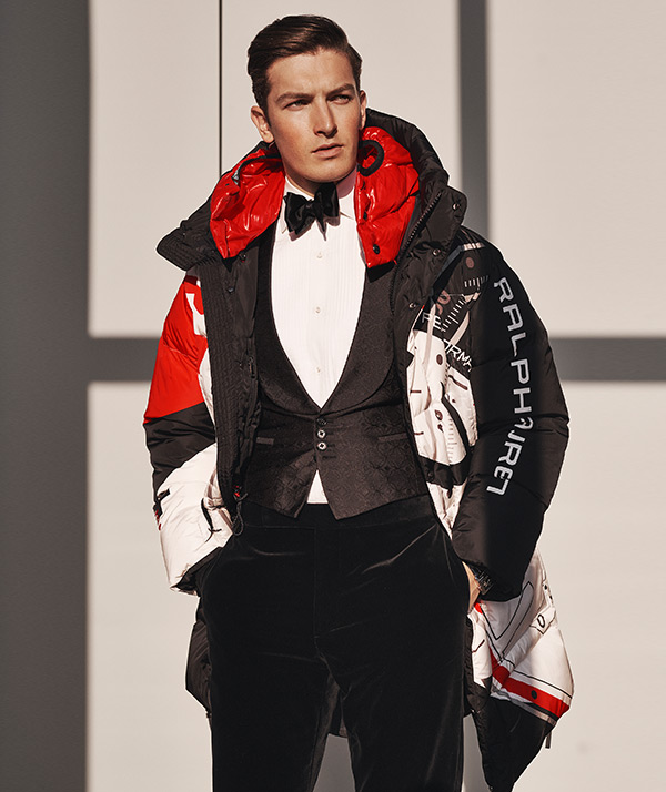 Man in black, red & white parka with ski-inspired graphics